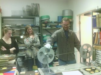 Nathan works with film while Prairie and Leslie look on